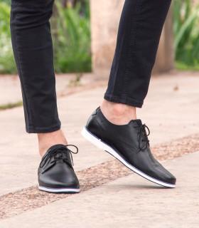 Zapatos de vestir de cuero azul base de goma blanca