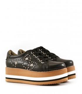 Zapatillas con plataforma de cuero con tachas en negro