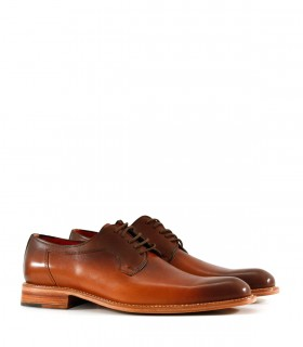 Zapatos de diseño en cuero suela