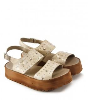 Sandalias base de cuero en oro