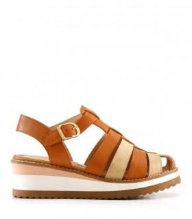 Sandalias caladas de cuero en suela combinada