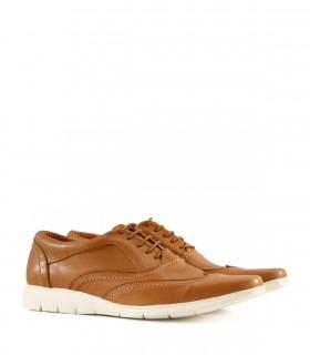 Zapatos de cuero acordonado en suela