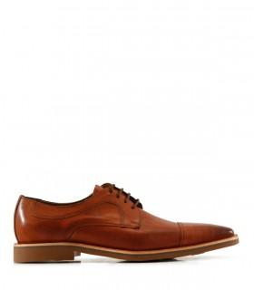 Zapatos de vestir de cuero en suela oscuro