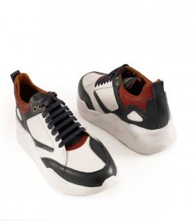 Zapatillas urbanas de cuero en blanco combinadas