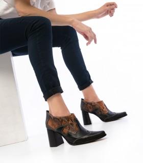 Botas cortas de cuero negro combinado