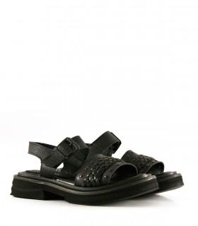Sandalias chatas con trenza de cuero negro